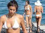 Irina Shayk is seen wearing a white bikini on July 17, 2015 in a lake in north of italy. Photo BEESCOOP.COM EXCLUSIVE