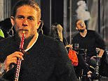 16.JULY.2015  - LONDON  - UK\n*** EXCLUSIVE ALL ROUND PICTURES ***\nSONS OF ANARCHY ACTOR CHARLIE HUNNAM IS SPOTTED OUT AND ABOUT IN LONDON WITH FRIENDS . THE ACTOR WENT UNNOTICED AS HE ENJOYED AN EVENING OUT IN LONDON SMOKING SOME SHEESHA AT A CENTRAL LONDON SHEESH RESTAURANT. THE ACTOR SEEMED TO ENJOY THE SHEESHA BY HIMSELF WITH HIS FRIENDS NOT SEEMING TO SHARE HIS ENTHUSIASM FOR THE SHEESHA PIPE . THE ACTOR WAS SPOTTED COUGHING AT ONE STAGE AND MADE SURE TO GET HIS LAST FEW HITS IN WHILST HIS FRIENDS WAITED FOR HIM .\nBYLINE MUST READ : XPOSUREPHOTOS.COM\n***UK CLIENTS - PICTURES CONTAINING CHILDREN PLEASE PIXELATE FACE PRIOR TO PUBLICATION ***\n**UK CLIENTS MUST CALL PRIOR TO TV OR ONLINE USAGE PLEASE TELEPHONE  442083442007