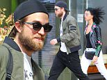 19.7.15....... Robert Pattinson and girlfriend FKA Twigs check out of their Manchester hotel on Sunday morning. Robert had been in the city to support his girlfriend who was performing as part of the Manchester International Festival.