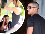 **EXCLUSIVE**  Date: July 17th 2015  Photo Credit: MOVI Inc.\\nNick Jonas chows down on a healthy oatmeal breakfast and manages to look good doing it. The newly single 'Jealous' singer could also be seen checking out some of the local talent as he waited for his friends to arrive at the cafe in West Hollywood,Ca.