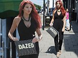 EXCLUSIVE: Amy Childs heads to her boutique to work , she looks dazed whilst carrying a bag that says 'DAZED'.\n\nPictured: Amy Childs\nRef: SPL1080630  180715   EXCLUSIVE\nPicture by: Jaimie / Splash News\n\nSplash News and Pictures\nLos Angeles: 310-821-2666\nNew York: 212-619-2666\nLondon: 870-934-2666\nphotodesk@splashnews.com\n