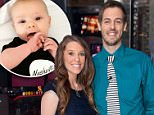 """NEW YORK, NY - OCTOBER 23:  Jill Duggar Dillard (L) and husband Derick Dillard visit """"Extra"""" at their New York studios at H&M in Times Square on October 23, 2014 in New York City.  (Photo by D Dipasupil/Getty Images for Extra)"""