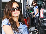 UK CLIENTS MUST CREDIT: AKM-GSI ONLY\nEXCLUSIVE: Beverly Hills, CA - Actress and model Megan Fox stops by a local gas station in Beverly Hills as she pumps her car.\n\nPictured: Megan Fox\nRef: SPL1082688  180715   EXCLUSIVE\nPicture by: AKM-GSI / Splash News\n\n