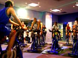 People at bike exercise classes at a gym. Spinning classes. Biking. Racing. Racers. gym body life lifestyle cardiovascular cardio bike classes fit healthy activity indoor group centre people BICYCLES CYCLE RACING CYCLISTS EXERCISE FITNESS GYMNASIUM HEALTH LEISURE POSED BY MODELS AMH925