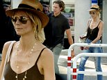 17 Jul 2015 - ROME - ITALY\n*** EXCLUSIVE ALL ROUND PICTURES NOT AVAILABLE FOR ITALY ***\nGERMAN SUPERMODEL HEIDI KLUM AND HER BOYFRIEND PICTURED ARRIVING AT FIUMICINO AIRPORT IN ROME\nBYLINE MUST READ : XPOSUREPHOTOS.COM\n***UK CLIENTS - PICTURES CONTAINING CHILDREN PLEASE PIXELATE FACE PRIOR TO PUBLICATION ***\n**UK CLIENTS MUST CALL PRIOR TO TV OR ONLINE USAGE PLEASE TELEPHONE 44 208 370 0291**