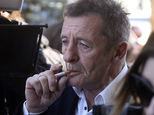FILE - In this Thursday, July 9, 2015 file photo, former AC/DC drummer Phil Rudd arrives for sentencing at the Tauranga District Court in Tauranga, New Zealand. Rudd has been arrested in New Zealand, just 10 days after he was sentenced to home detention for threatening to kill a man who used to work for him. The New Zealand Herald reported Sunday, July 20 that Rudd was arrested at his New Zealand home on Saturday, though police refused to comment on the nature of the arrest. (Alan Gibson/New Zealand Herald via AP, File) NEW ZEALAND OUT, AUSTRALIA OUT