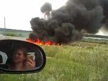MH17 - Witness footage - 1 - must credit YOUTUBE, EAST2WEST NEWS - queries Will Stewart on 0079859989400.jpg