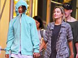UK CLIENTS MUST CREDIT: AKM-GSI ONLY EXCLUSIVE: **SHOT ON 7/16/15** New York, NY - Young rapper/actor Jaden Smith seen holding hands with his new girlfriend in NYC. Jaden tried to cover his famous face with a hoodie while his girl kept a shy smile on her face and enjoyed the walk along the streets of the Big Apple.  Pictured: Jaden Smith Ref: SPL1081740  170715   EXCLUSIVE Picture by: AKM-GSI / Splash News