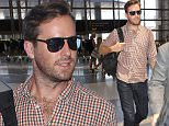 Armie Hammer casual and cute at LAX. He's been out and about promoting his new project The Man From UNCLE Sunday, July 19, 2015. X17online.com