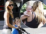 LONDON, ENGLAND - JULY 18:  (EXCLUSIVE COVERAGE)(MINIMUM PRINT USAGE FEE £150 PER IMAGE)(MINIMUM ONLINE/WEB USAGE FEE £150 FOR SET) British Model Abbey Clancy is pictured taking her children out for a stroll in the sunshine on July 18, 2015 in London, England.  (Photo by Crowder/Legge/GC Images)