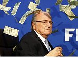 British comedian known as Lee Nelson holds banknotes in front of FIFA President Sepp Blatter (L) at a news conference after the Extraordinary FIFA Executive Committee Meeting at the FIFA headquarters in Zurich, Switzerland July 20, 2015. World football's troubled governing body FIFA will vote for a new president, to replace Sepp Blatter, at a special congress to be held on February 26 in Zurich, the organisation said on Monday.       REUTERS/Arnd Wiegmann