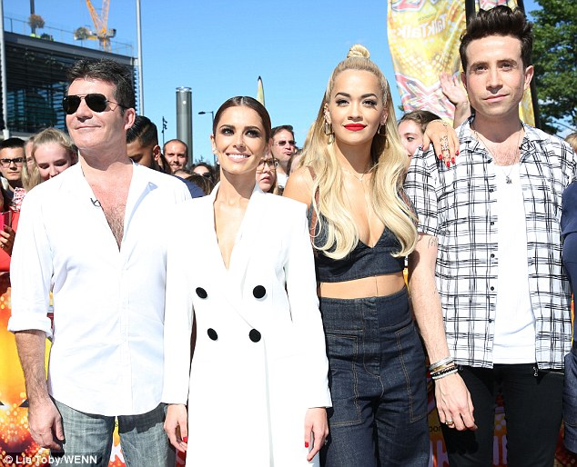 New squad: Rita has been welcomed to the judging panel by Simon Cowell and Cheryl-Fernandez-Versini - alongside fellow newcomer Nick Grimshaw - with open arms