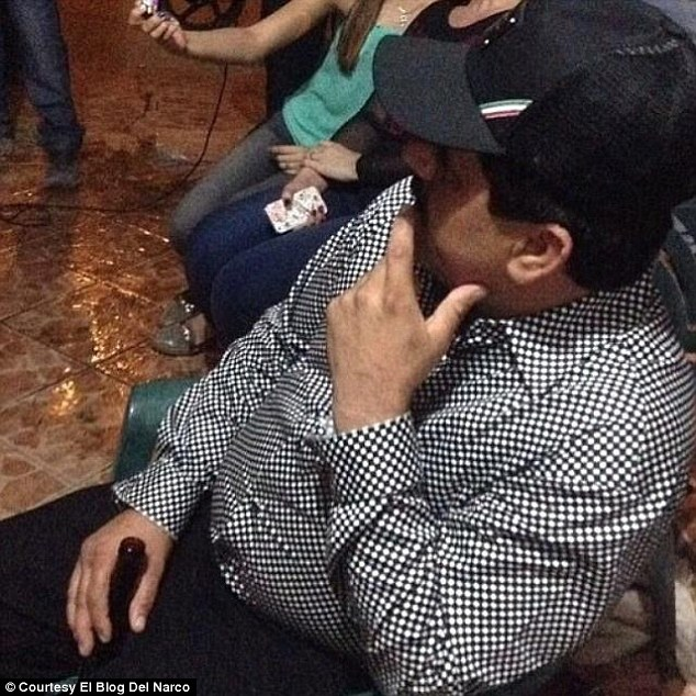 Relaxed: El Chapo is pictured here in another photograph which was released to the blog by one of Guzman's sons. Notable is that he appears to be in public just hours after his prison break