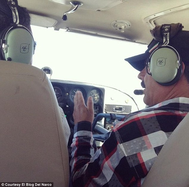 Flight to safety: According to the El Blog Del Narco the man in the picture on the right is Joaquin 'El Chapo' Guzman and was taken less than two days after his brazen escape from jail in Mexico on Saturday
