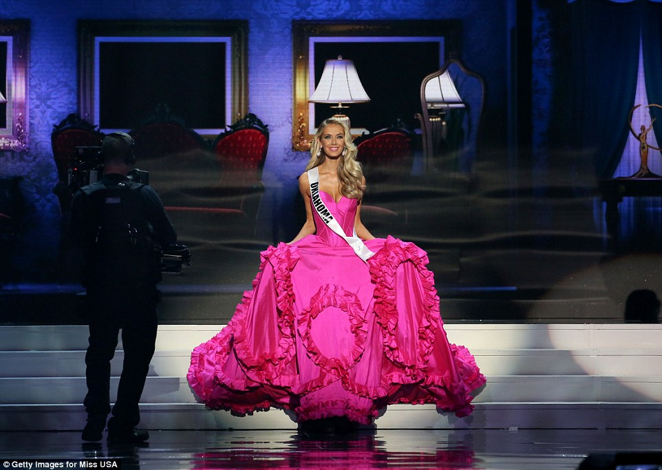 Miss USA 2015 Olivia Jordan walks across stage in her hot pink ballgown that featured ruffles across the bottom and a plunging necklne