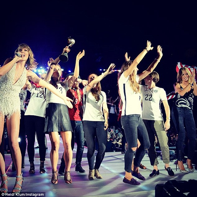 Runway ready: Heidi Klum shared an Instagram photo of herself on stage alongside the champion US women's soccer team during the Taylor Swift concert in East Rutherford, New Jersey
