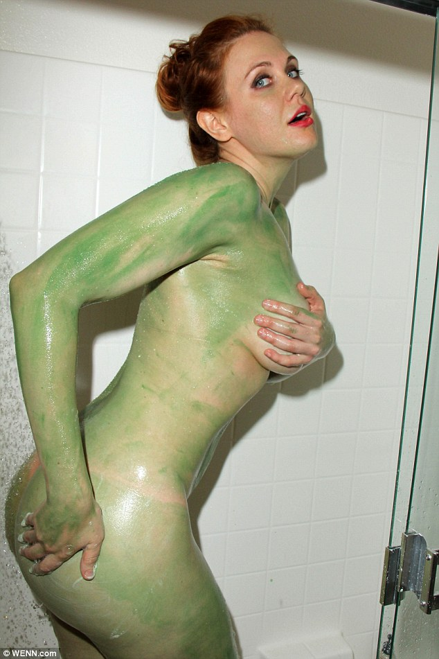Exposed: The beauty kept her make-up intact and set about scrubbing the paint job off her naked body