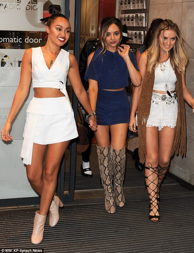 Keeping close: The group were preened to perfection as they rounded up another promo appearance