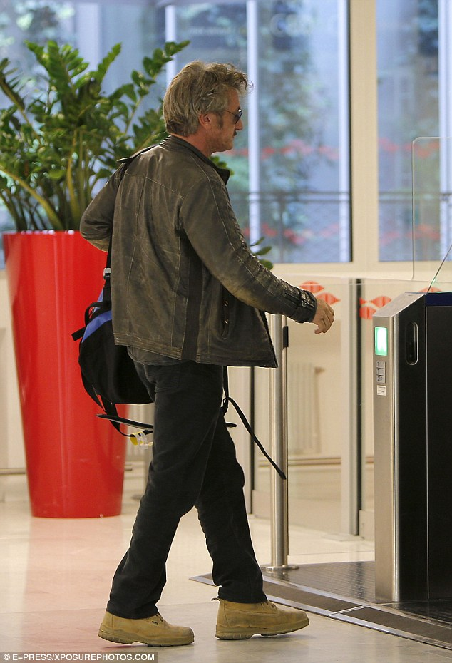 Glum: Sean looked rather serious as he headed through Paris' Roissy airport