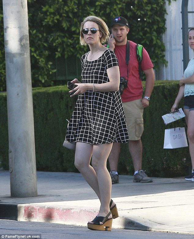 Monochrome missy: The 36-year-old Mean Girls star teamed her dress with a pair of wegdes