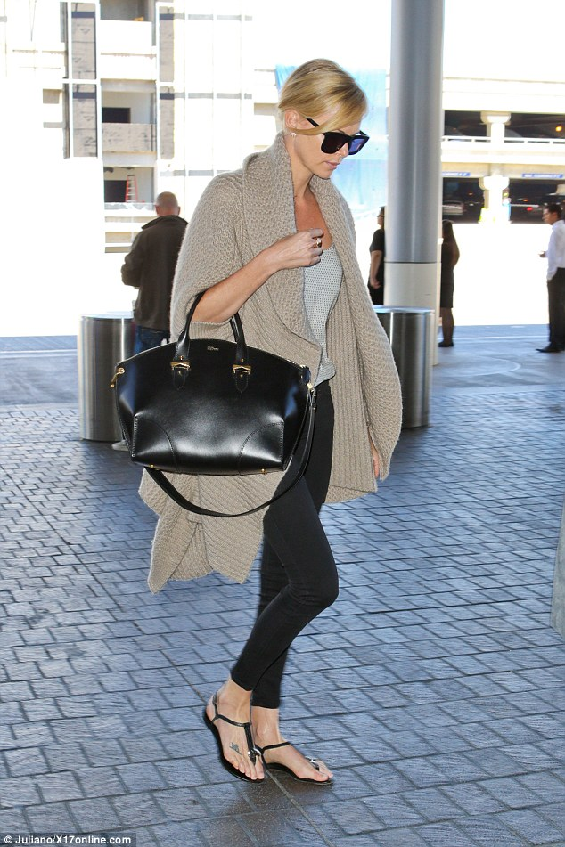 Cosy: Charlize wrapped up in a loose fitting nude cardigan, over a scoop neck grey top