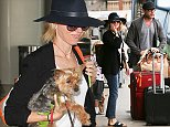 July 20, 2015: Naomi Watts and Liev Schreiber with sons Samuel and Alexander arrive at LAX airport for a departure, Los Angeles, CA.\nMandatory Credit: INFphoto.com Ref.: inf-00