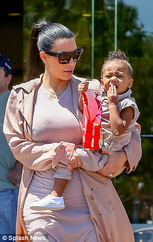 Oh no! Kim looked lovingly at her little girl but no doubt she got a surprise when she saw what had happened