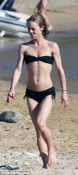 Bit chilly? The French beauty appeared to find the Greek waters a little cold as she hurried back to the beach