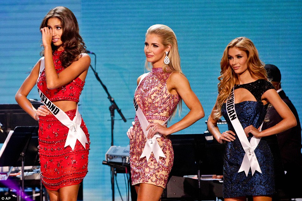 Miss Rhode Island Anea Garcia, left, reacts after making the top fifteen during the 2015 Miss USA pageant. Miss Michigan Rashontae Wawrzyniak, right, also made it into the next round