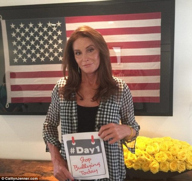 Talking back: Cailtyn Jenner told her followers on Monday that she will never go back to being Bruce as she shared a photo where she was holding up a sign that read, 'Stop bullying today'