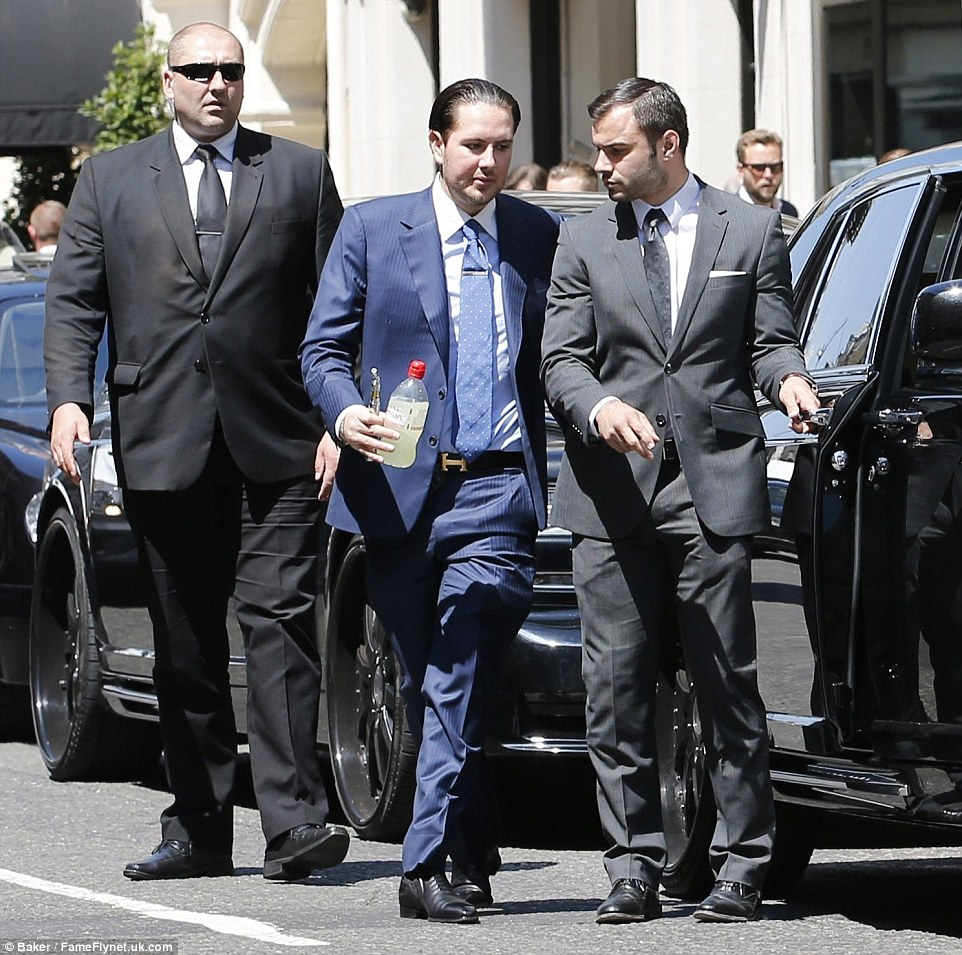 The 33-year-old was surrounded by his security team as he emerged from the auction house with a collection of new purchases