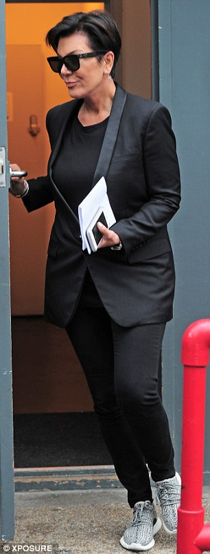 Back to black: After showing off some more flamboyant looks over the weekend, Kris, 59, was back in her favourite colour on Monday