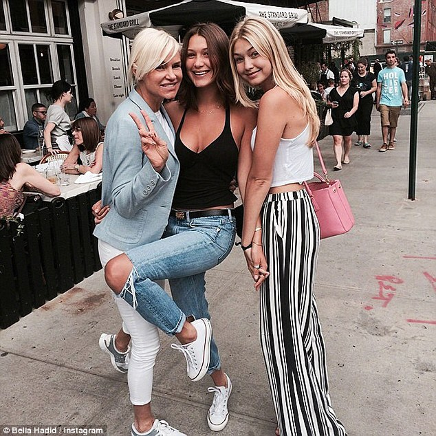 Look at them now: Yolanda, 51, is pictured in August 2014 with daughters Bella, center, and Gigi