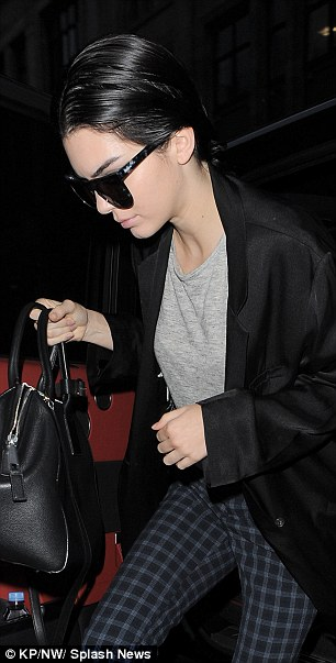 Back to base: Kendall added a smart black coat to her look and hid behind €90 KOMONO 'Bennet' sunglasses
