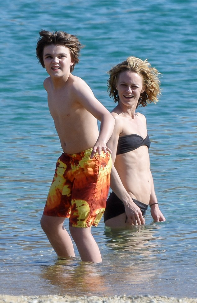 Beach day: Jack was dressed in a pair of colouful swimming shorts for his ocean dip