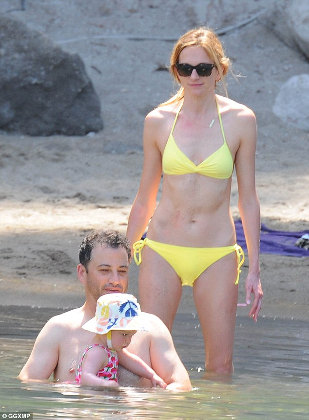 Cooling off: Jimmy's wife Molly McNearney looked gorgeous in a sunshine yellow bikini as the family bathed at a resort in Ischia - off the coast Naples