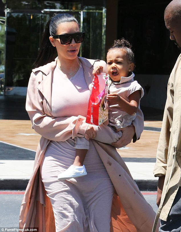 Pink-credible! North wore a co-ordinating outfit to her mother's look for the family occasion