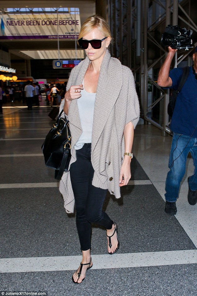 Jetting off: It's back to business for Charlize Theron, putting the woes of her broken engagement to Sean Penn behind her as she left LAX on Sunday