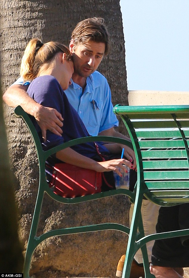 Emotional: Actor Luke Wilson consoled his former flame Meg Simpson while on a beach in Santa Monica on Sunday - the pair broke up in November following a six year relationship