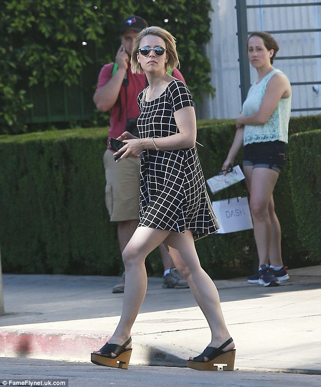 Casual chic: Rachel hid her eyes behind a pair of reflective sunglasses as she appeared to go make-up free