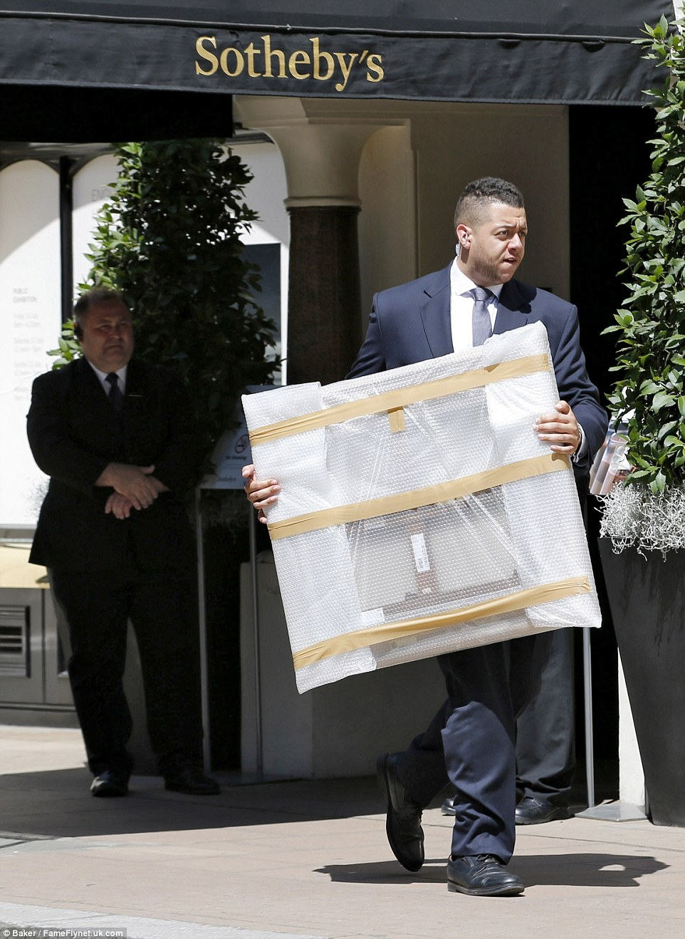 Mr Stunt's vast entourage was seen carrying several large paintings out from Sotheby's to the waiting collection of cars