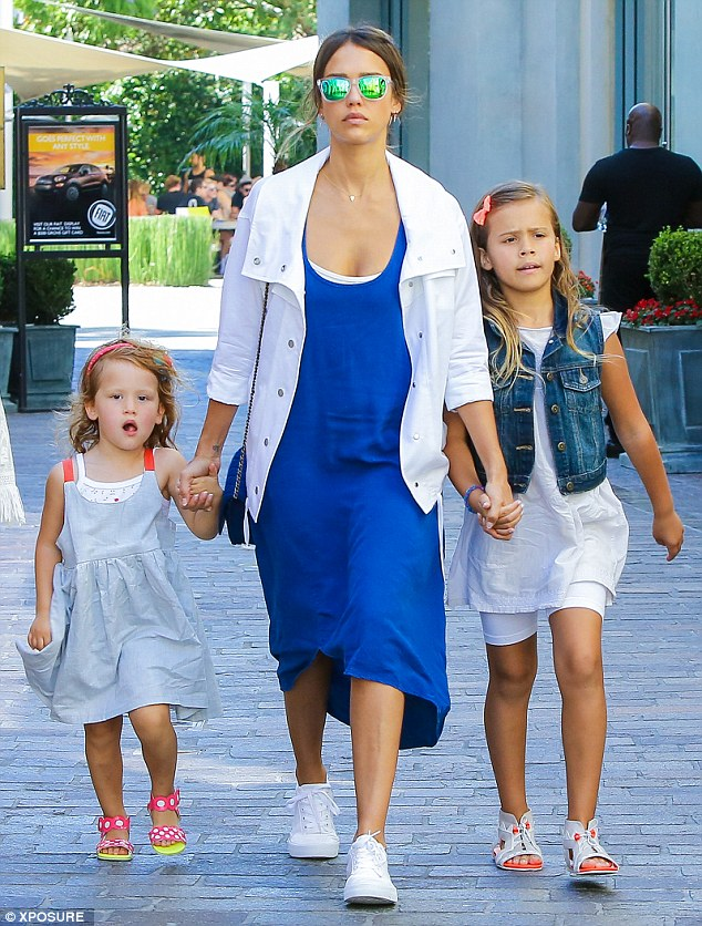 Girls' day out: Jessica Alba looked cool and casual as she slipped into a skintight electric blue maxi dress for a day out with her daughters, Honor Marie, seven, and Haven, three