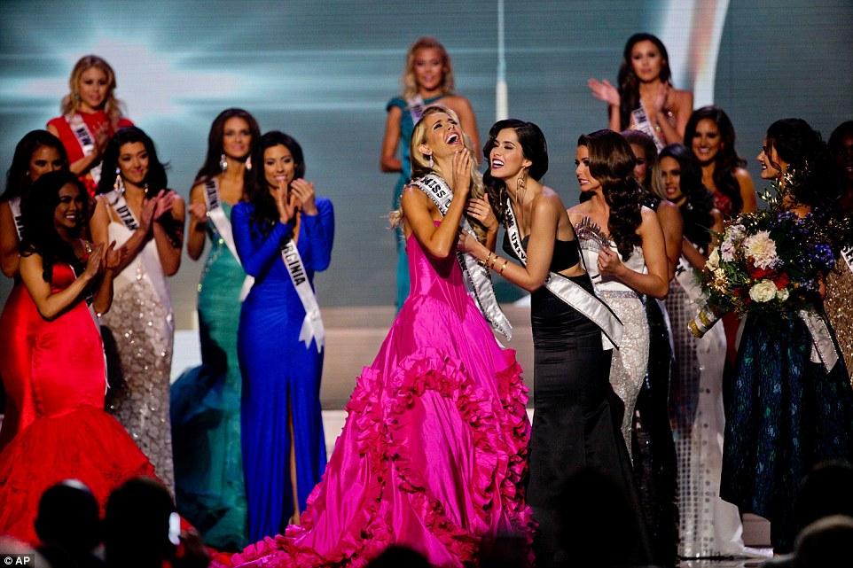 Miss Universe Paulina Vega adorns Miss Oklahoma Olivia Jordan with a new sash after she's named 2015 Miss USA