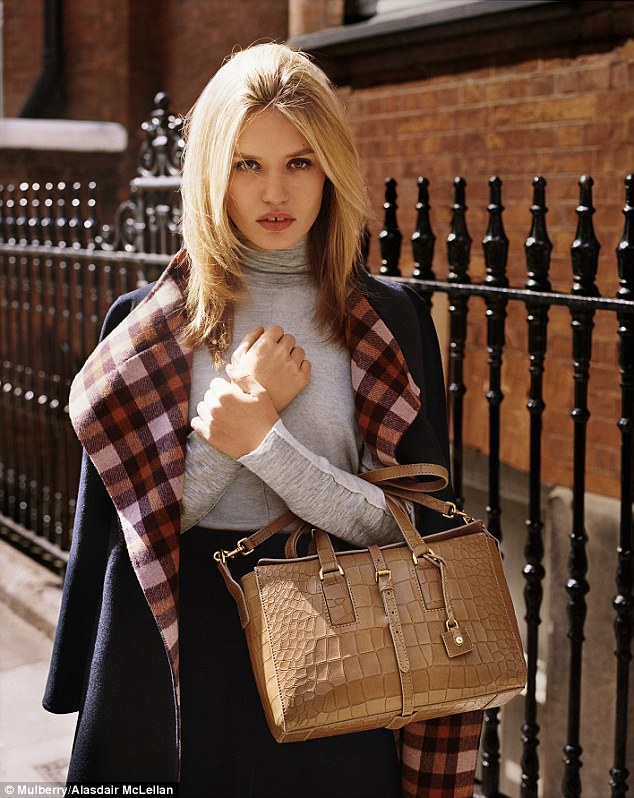 In a check-lined wool coat Georgia Jagger is seen clutching Mulberry's new leather Roxette bag. A lightweight version of Mulberry's existing Roxanne tote, the bag starts from £995 for the small version