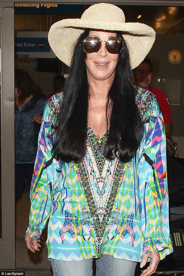 Bohemian star: The Believe singer wore an hippy-style long-sleeved multi-coloured print top as she arrived back in Los Angeles, after a trip to London