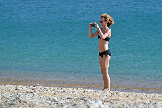 Say cheese: Standing on the waters' edge, Vanessa snapped away on her camera
