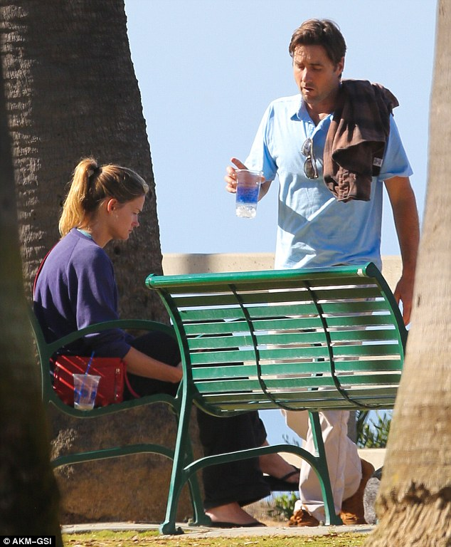 Lots to talk about: Luke carried a cup of water as Meg appeared lost in her thoughts and a little teary