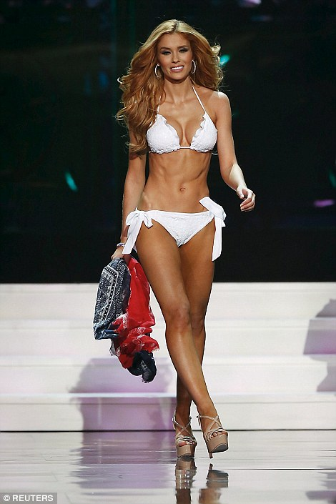 Miss Michigan USA Rashontae Wawrzyniak struts her stuff during the swimsuit round of the Miss USA pageant