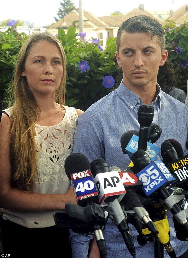 Denise Huskins and her boyfriend Aaron Quinn, who police suspected of hoaxing a bizarre kidnapping plot, front a press conference on Monday night