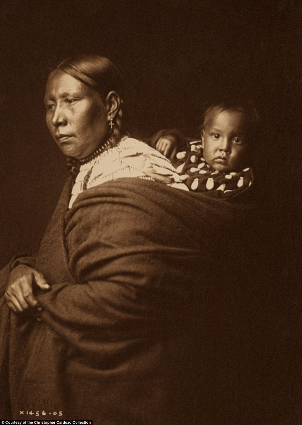 This 1905 photo, 'Sioux Mother and Child', is accompanied by an essay that notes the references children being taken away to boarding schools run by the U.S. government
